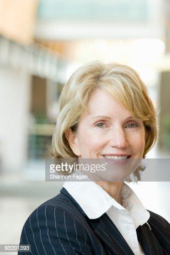 Businesswoman smiling : Stock Photo