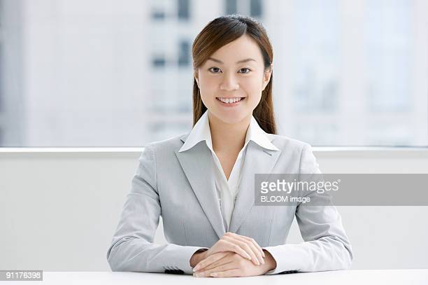 Businesswoman smiling, portrait, close-up