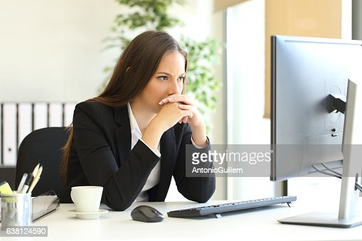 Businesswoman solving a difficult assignment : Stock Photo