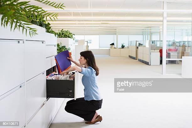 Businesswoman Sorting File Folders