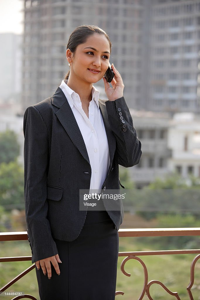 Businesswoman speaking on cellphone : Stock Photo