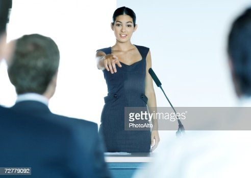 Businesswoman speaking with microphone during seminar : Stock Photo