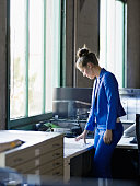Businesswoman standing at office workstation