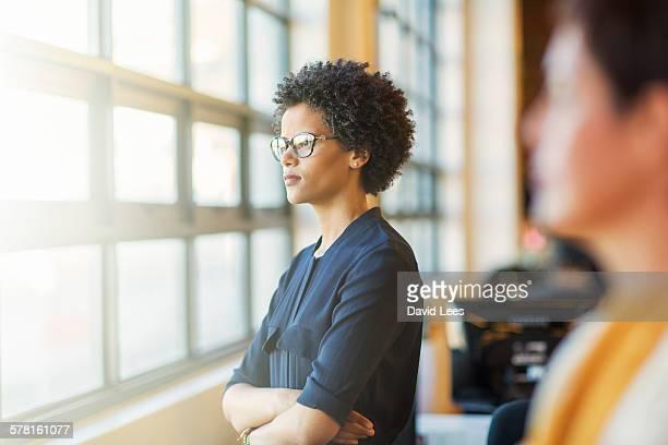 Businesswoman standing by office window