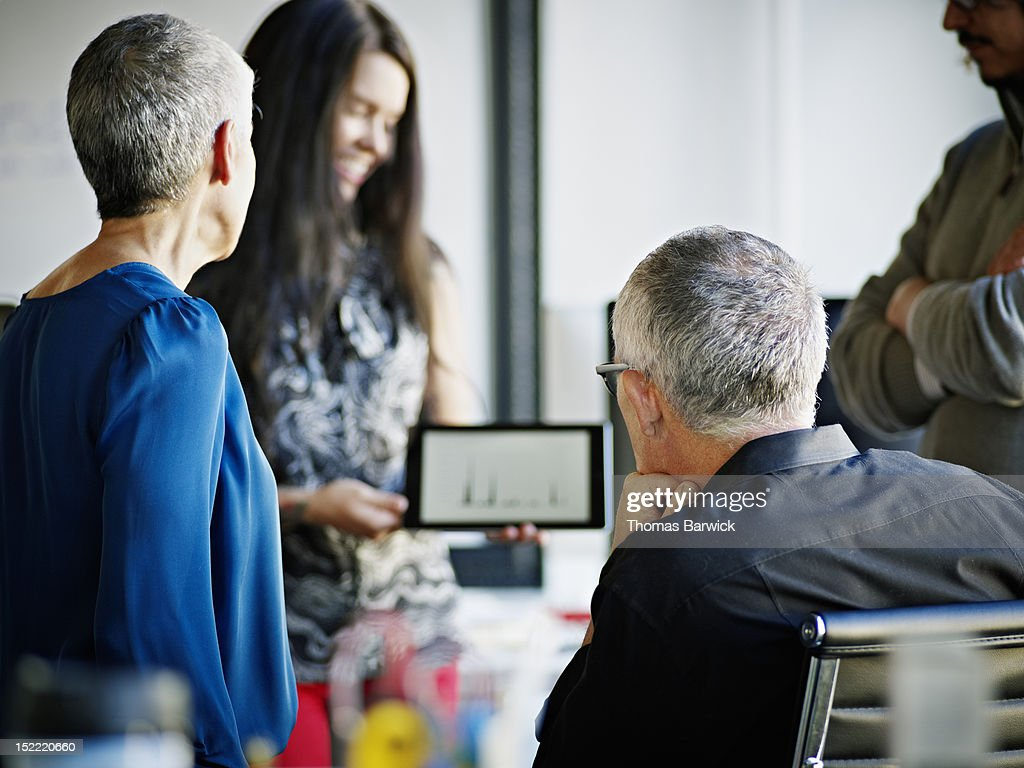 Businesswoman standing holding digital tablet : Stock Photo