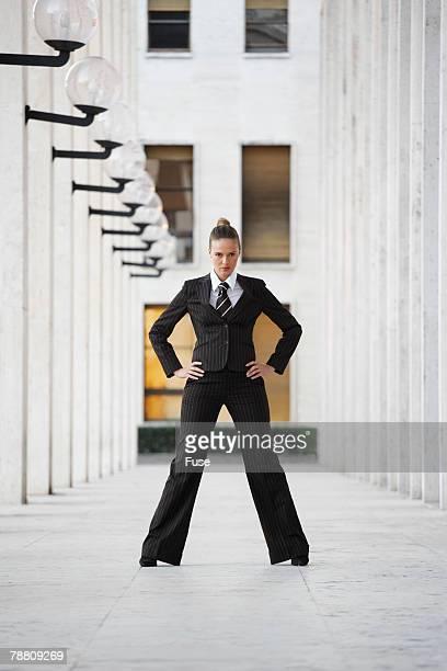Businesswoman Standing in Arcade