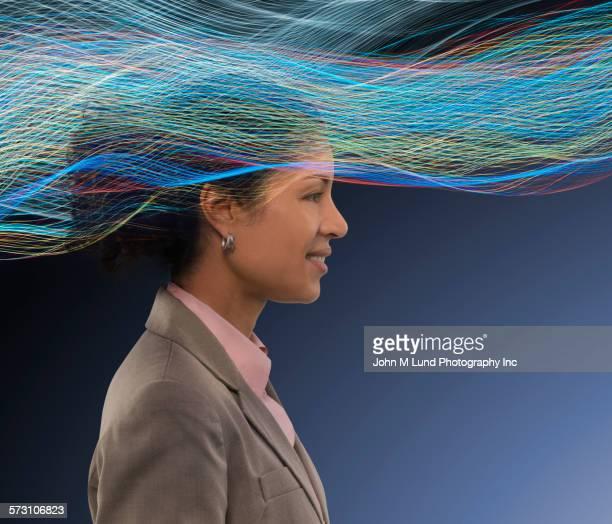 Businesswoman standing in light stream