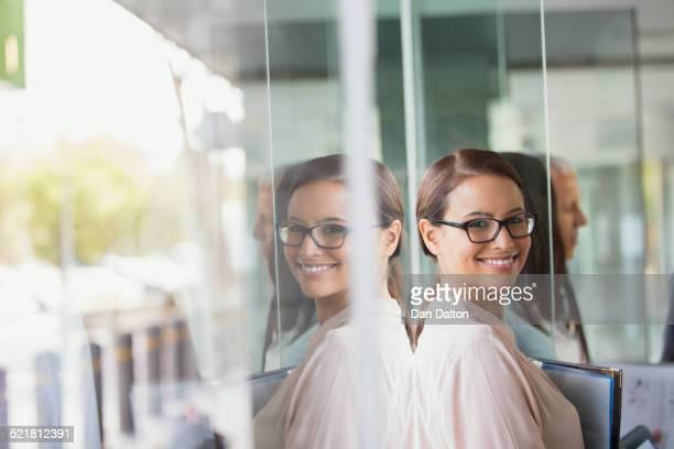 Businesswoman standing in office building