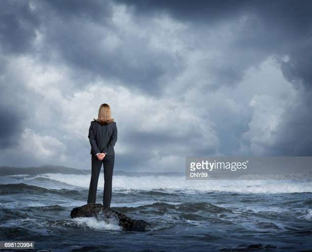 Businesswoman Standing In Rough Ocean Surf