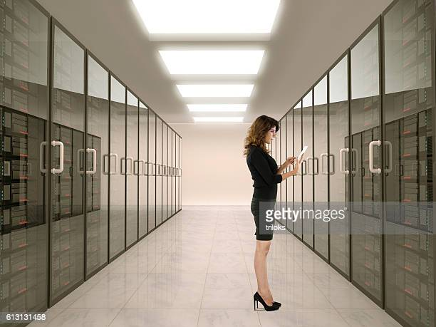Businesswoman standing in server room