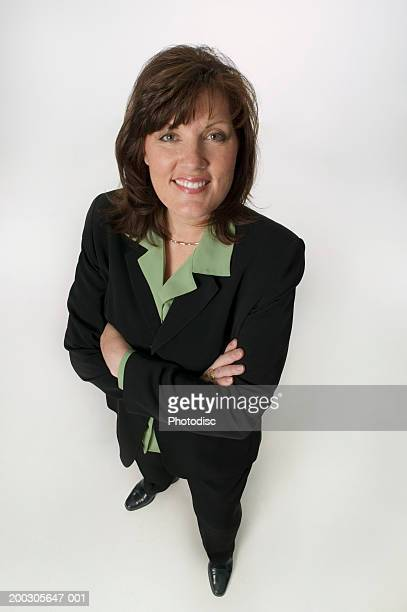 Businesswoman standing in studio, portrait, elevated view