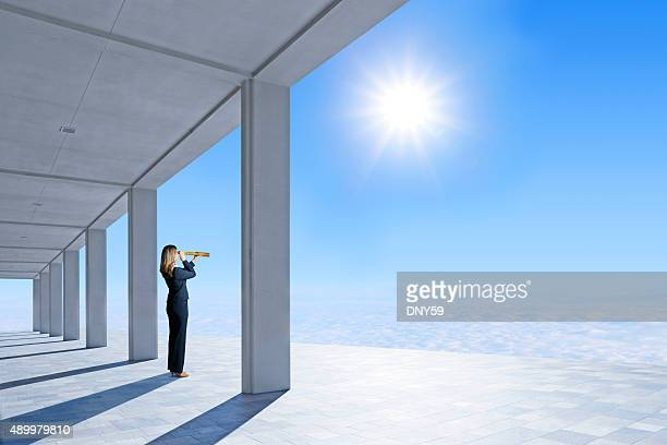 Businesswoman Standing On Pavilion Looking Through Spyglass