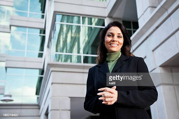 Businesswoman standing outside office building