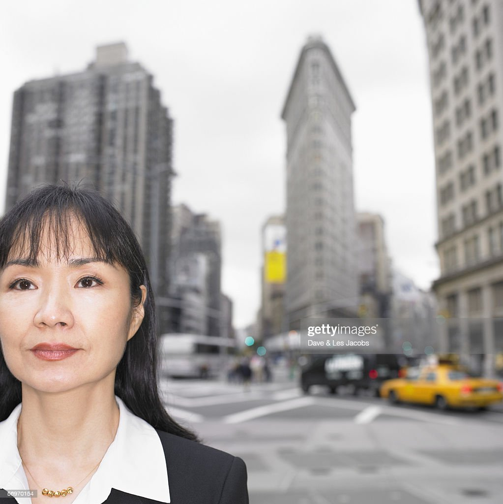 Businesswoman standing with cityscape behind her : Stock Photo