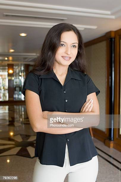 Businesswoman standing with her arms crossed in a hotel
