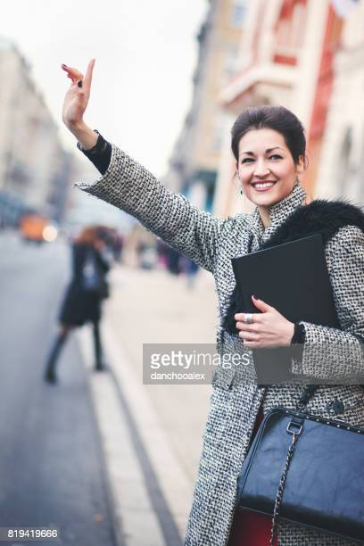 Businesswoman stopping a taxi