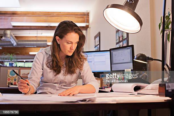 Businesswoman studies paperwork