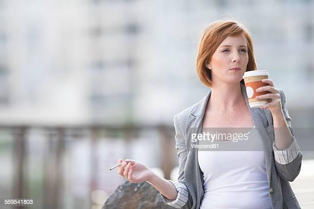 Businesswoman taking a break, drinking coffee