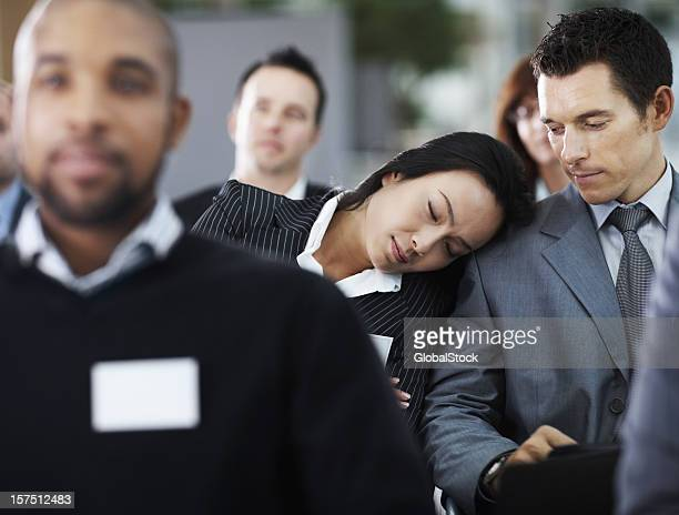 Businesswoman taking a nap during conference