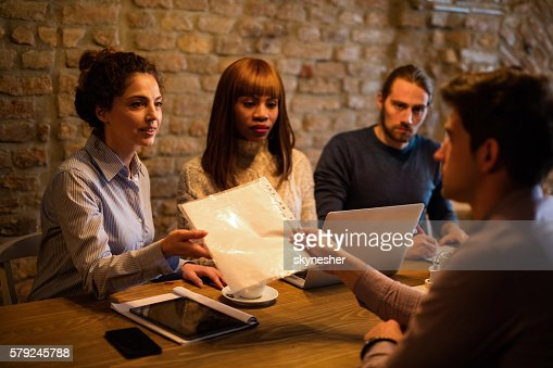 business woman presenting her résumé during interview stock photo