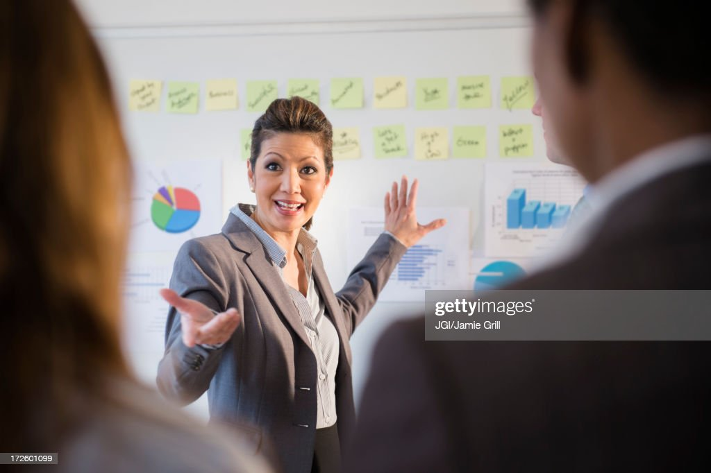 Businesswoman talking in meeting : Stock Photo