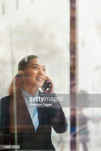 Businesswoman talking on a smartphone : Stock Photo
