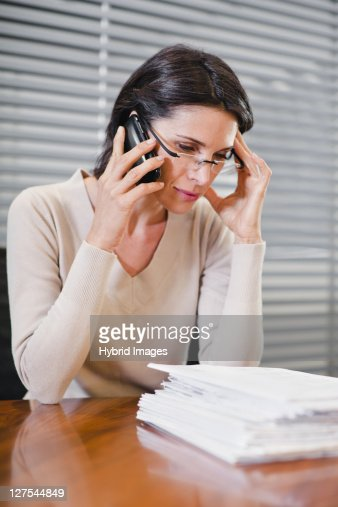 Businesswoman talking on cell phone : Stock Photo