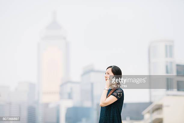 Businesswoman talking on smartphone in city street