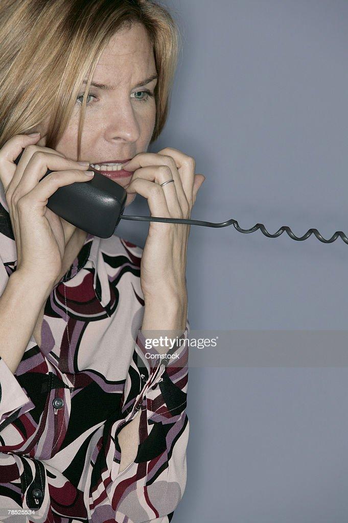 Businesswoman talking on telephone : Stock Photo