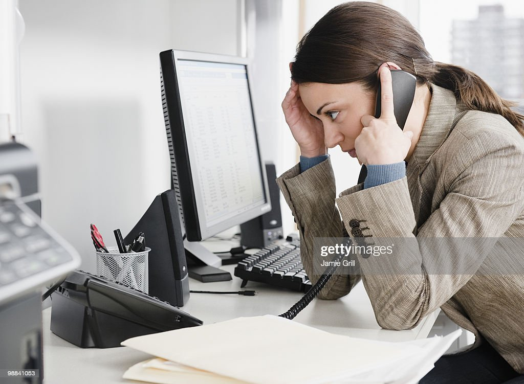 Businesswoman talking on the phone in office : Stock Photo