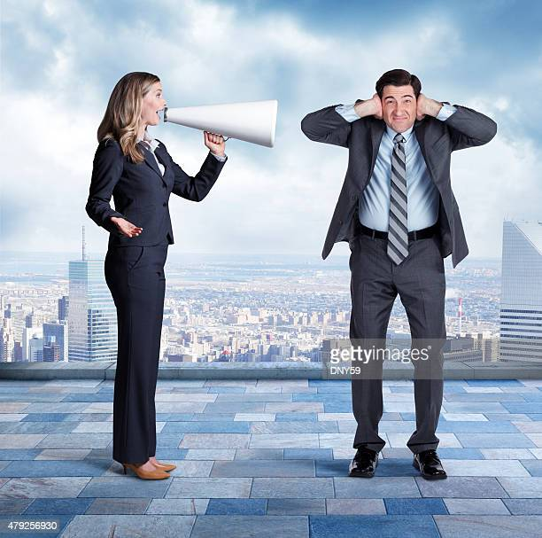 Businesswoman Talking To Businessman Through Megaphone