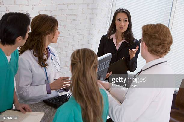 Businesswoman talking to medical professionals