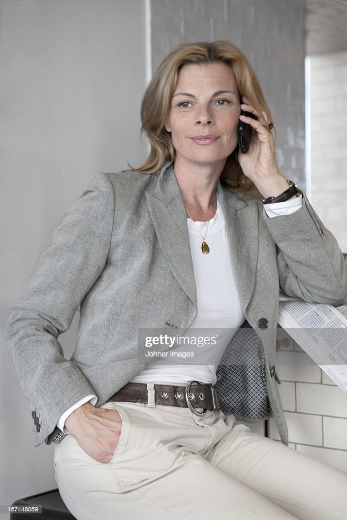 Businesswoman talking via cell phone : Stock Photo