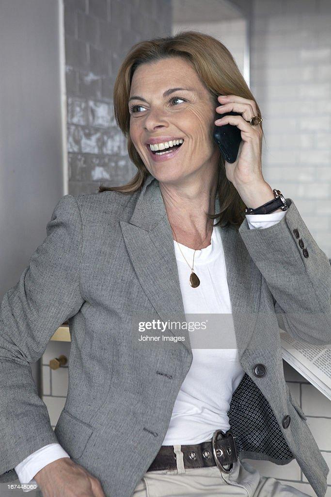 Businesswoman talking via cell phone : Stock Photo