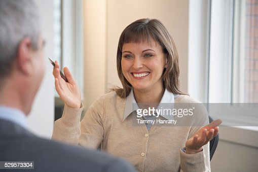 Businesswoman talking with colleague : Stock Photo
