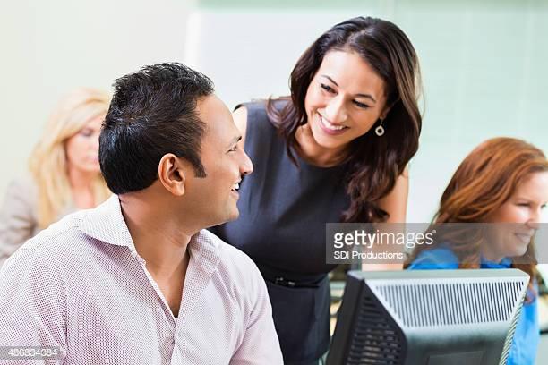 Businesswoman teaching job training course in computer lab