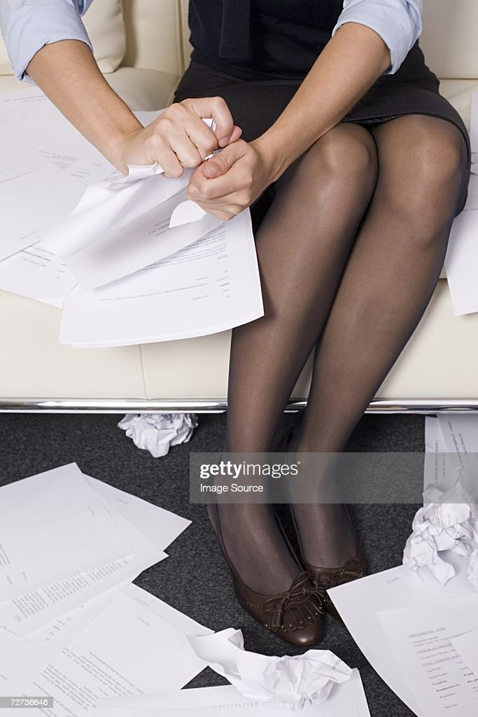Businesswoman tearing up documents : Stock Photo