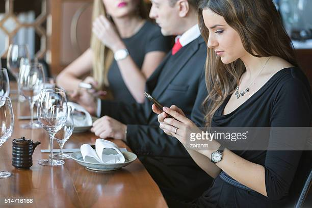 Businesswoman texting during lunch