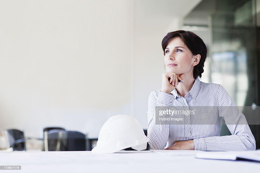 Businesswoman thinking at desk : Stock Photo
