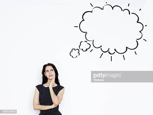Businesswoman thinking. Thought bubble above
