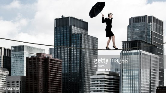 Businesswoman tightrope walker