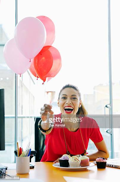 Businesswoman toasting at office party
