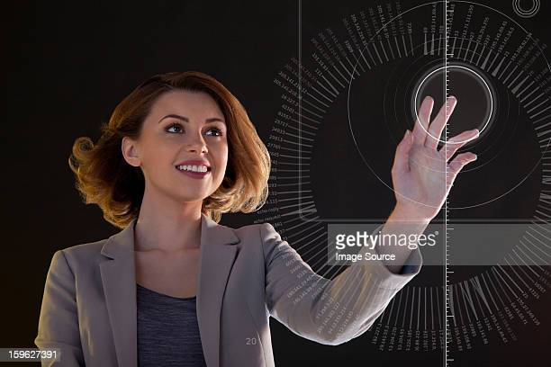 Businesswoman touching digital symbol