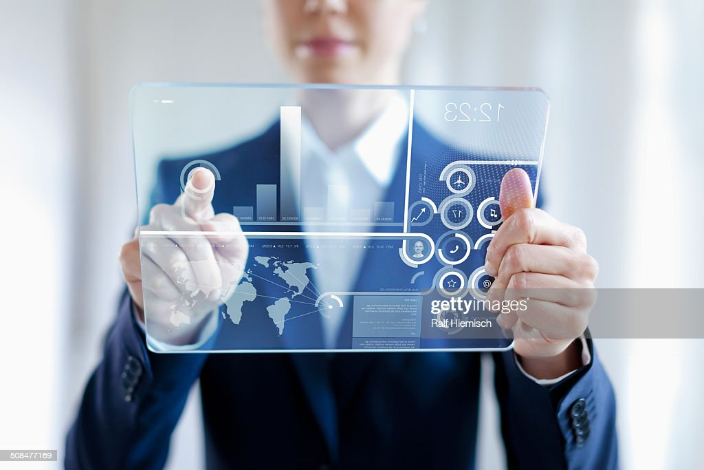 Businesswoman Touching On Futuristic Glass Digital Tablet With Graph : Stock-Foto