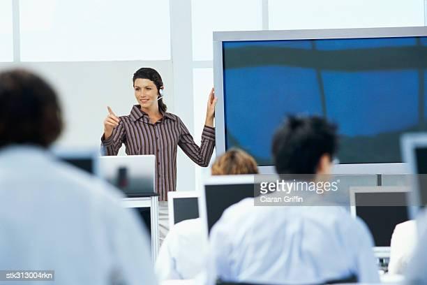 businesswoman training business executives at a seminar