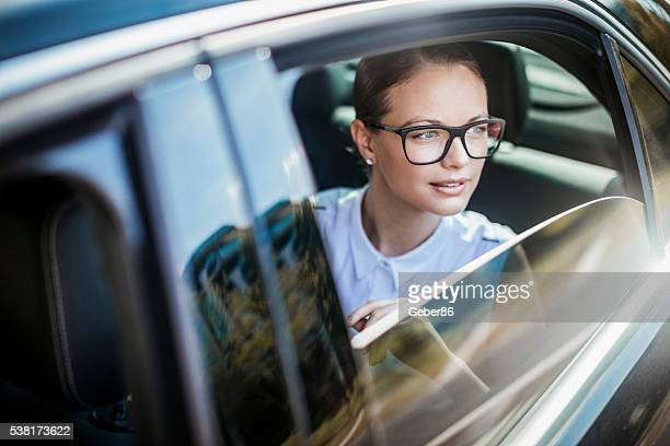 Businesswoman traveling in a car