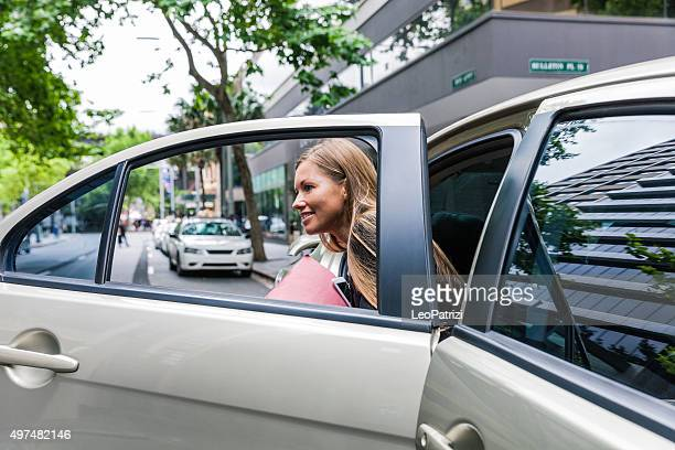 Businesswoman travelling by car in downtown