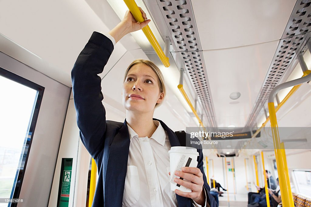 Businesswoman travelling on London Overground train : Stock Photo