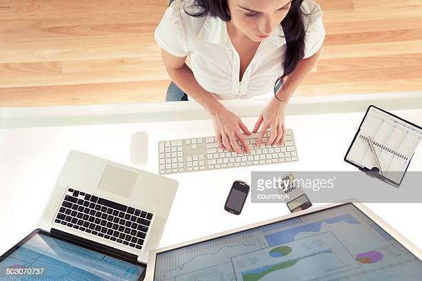 Businesswoman typing at her computer