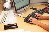 Businesswoman typing on computer keyboard